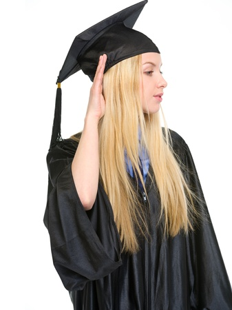Young woman in graduation gown listening Stock Photo - 18938238