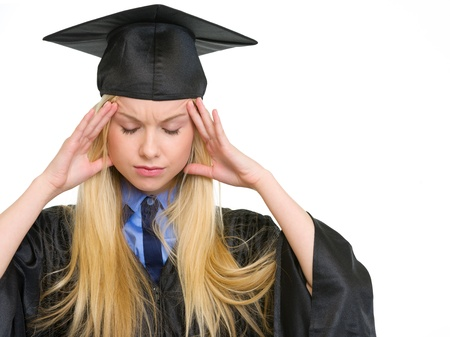 Portrait of stressed young woman in graduation gown Stock Photo - 18938231