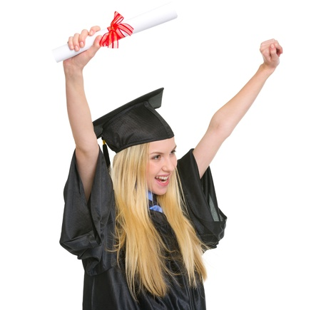 Happy young woman in graduation gown with diploma rejoicing success photo