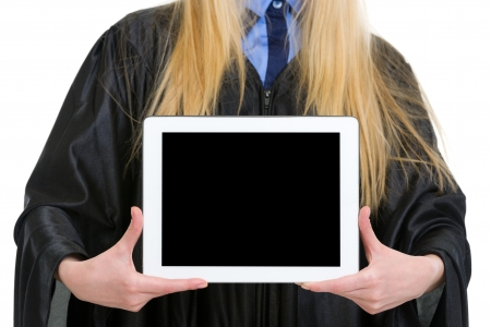 Closeup on tablet pc in hand of woman in graduation gown photo