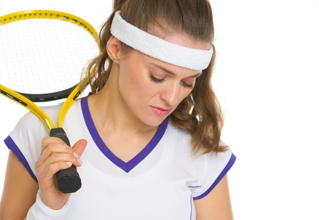 disquieted: Portrait of concerned female tennis player with racket