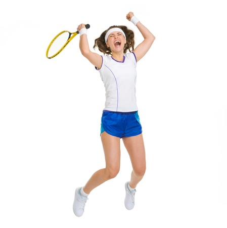 Happy female tennis player jumping photo