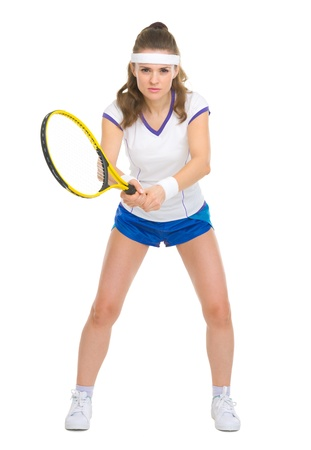 Confident female tennis player in stance photo