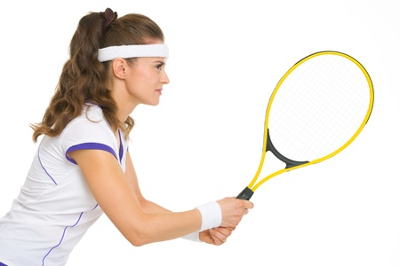 Confident female tennis player in stance . side view photo