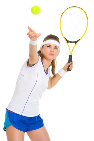 Female tennis player serving ball photo