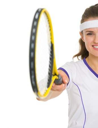 Closeup on female tennis player pointing racket in camera photo