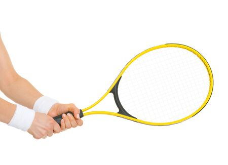 Closeup on hand of female tennis player holding racket photo