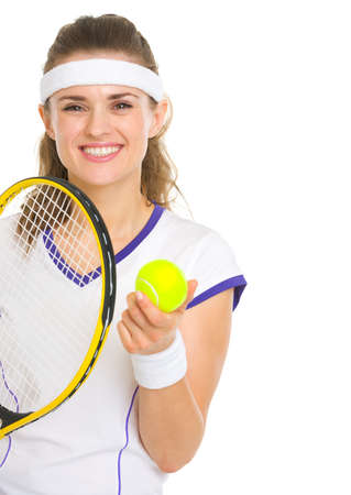 Smiling female tennis player with racket and ball photo
