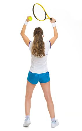 Full length portrait of female tennis player rejoicing success . rear view photo