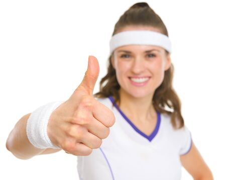 Closeup on smiling female tennis player showing thumbs up photo