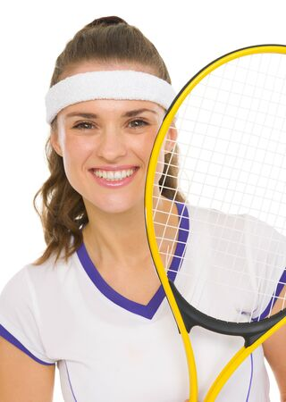 Portrait of happy female tennis player with racket photo