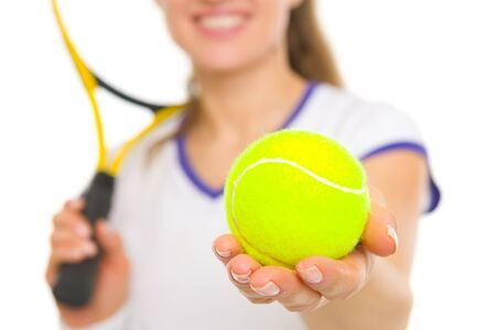 Closeup on ball in hand of female tennis player photo