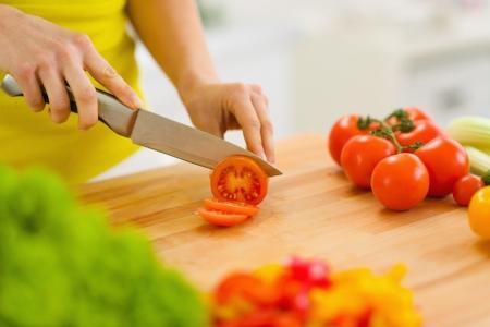 Closeup on woman cutting tomato Stock Photo - 19093452