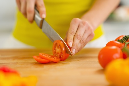 Closeup on woman cutting tomato Stock Photo - 19093456