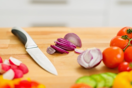 Closeup on onion and knife on cutting board Stock Photo - 19113360