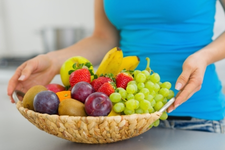 Closeup on plate with fruits in hand of young woman Stock Photo - 19093548