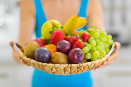 Closeup on plate of fresh fruits giving by woman Stock Photo - 19093449