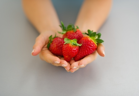 Closeup on hands with strawberries Stock Photo - 19093448