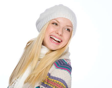 Portrait of smiling girl in winter clothes looking on copy space Stock Photo - 19226697