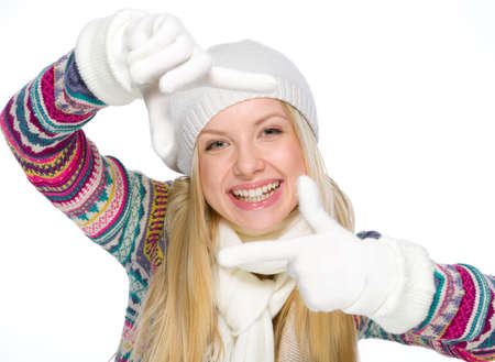 Smiling girl in winter clothes framing with hands Stock Photo - 19226716