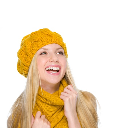 Smiling girl in autumn clothes looking on copy space Stock Photo - 19226715