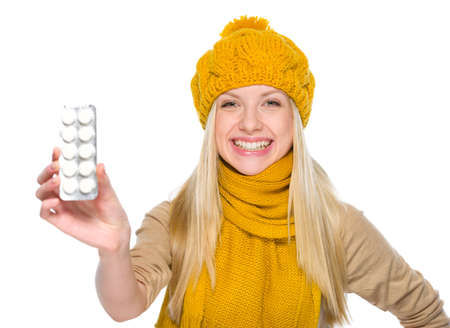Happy girl in autumn clothes showing pills pack Stock Photo - 19226718