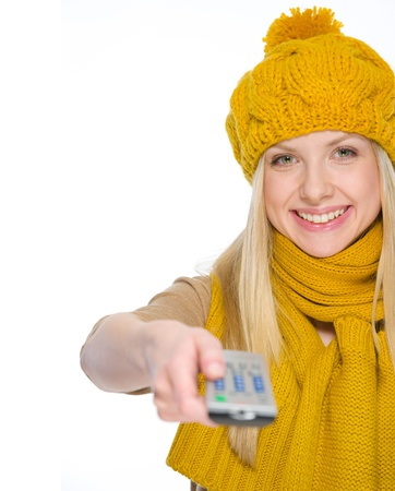 Happy girl in autumn clothes using tv remote control Stock Photo - 19226727