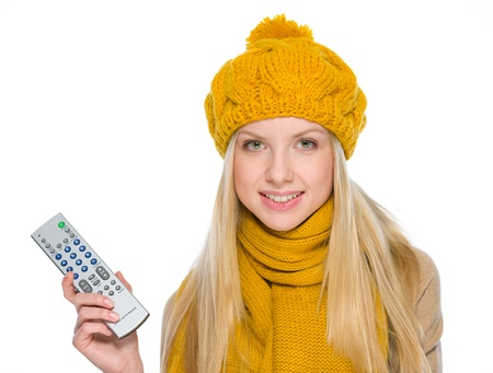 Happy girl in autumn clothes with tv remote control Stock Photo - 19226706