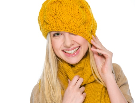 Smiling girl in autumn clothes pulling hat over head Stock Photo - 19226721