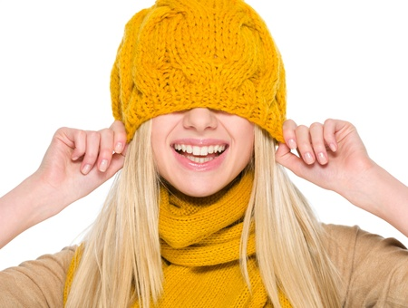 Smiling girl in autumn clothes with hat over head Stock Photo - 19226728