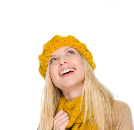 Portrait of smiling girl in autumn clothes looking up on copy space Stock Photo - 19226702