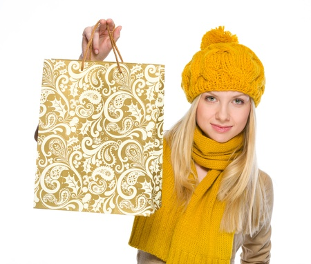 Happy girl in autumn clothes showing shopping bag Stock Photo - 19226711