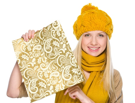 Smiling girl in autumn clothes showing shopping bag Stock Photo - 19226725