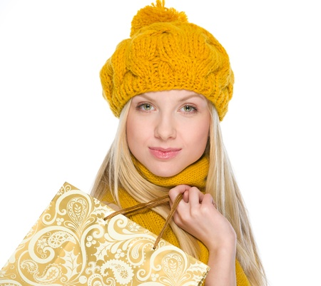 Smiling girl in autumn clothes with shopping bag Stock Photo - 19226772