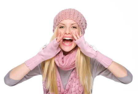 Happy girl in winter clothes shouting through megaphone shaped hands Stock Photo - 19226773