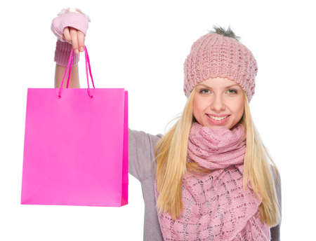Smiling girl in winter clothes showing shopping bags Stock Photo - 19226735