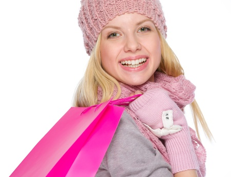 Smiling girl in winter clothes with shopping bags Stock Photo - 19226736