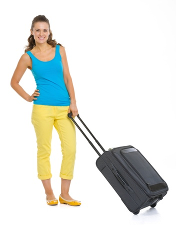Full length portrait of happy young tourist woman with wheel bag Stock Photo - 19339961