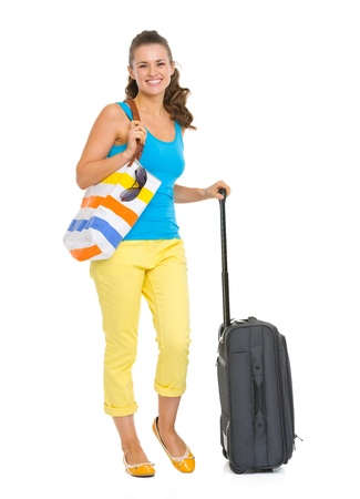 Full length portrait of happy young tourist woman with wheel bag Stock Photo - 19339971