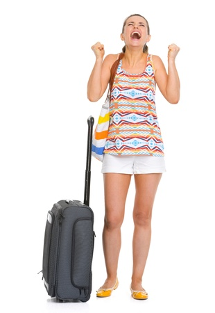 Full length portrait of happy young tourist woman with wheel bag enjoing vocation photo