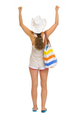 Full length portrait of beach young woman rejoicing success . rear view Stock Photo - 19339958
