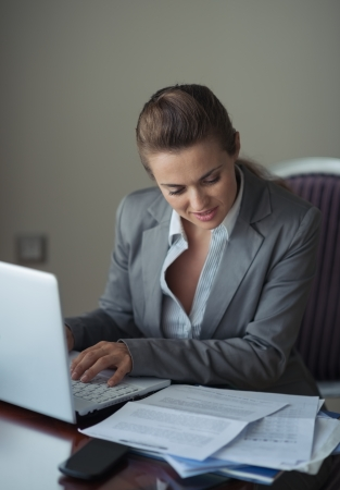 topicality: Business woman working with documents and laptop