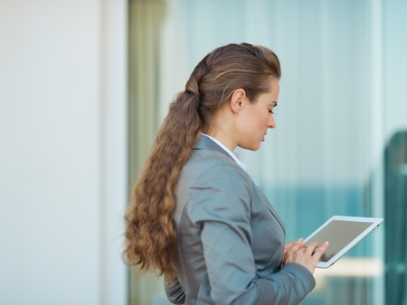 topicality: Business woman working with tablet pc