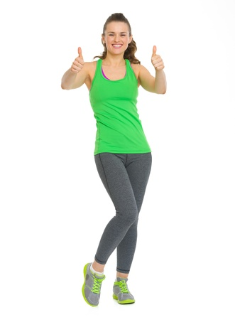 Full length portrait of happy fitness young woman showing thumbs up Stock Photo - 19505537