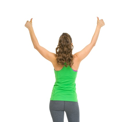 Fitness woman rejoicing success . rear view