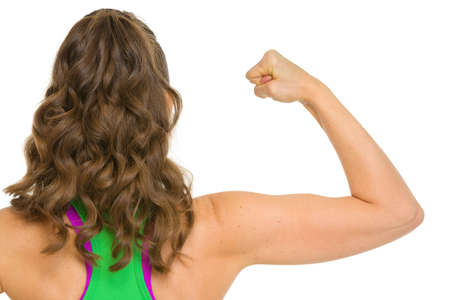 surety: Fitness woman showing biceps . rear view Stock Photo