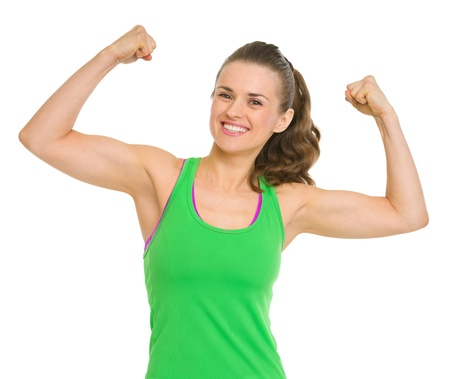showing muscles: Happy fitness young woman showing biceps
