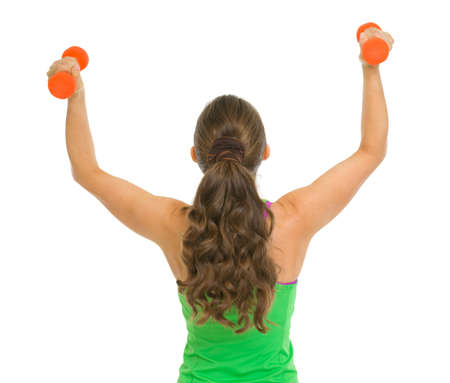 rejoicing: Fitness woman with dumbbells rejoicing success
