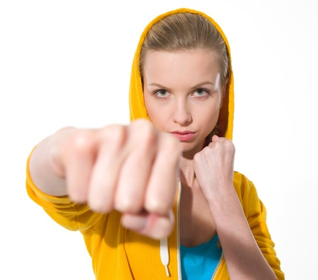 girl punch: Teenager girl punching Stock Photo