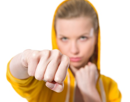 youthfulness: Closeup on teenager girl punching Stock Photo